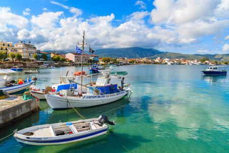 sep: SAMOS ISLAND, GREECE - SEP 23, 2015: colorful fishing boats in small port on coast of Samos island, Greece.