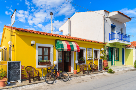 SAMOS ISLAND, GREECE - SEP 24, 2015: colourful building of Italian restaurant on street of Kokkari town, Samos island, Greece.