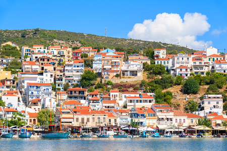 SAMOS ISLAND, GREECE - SEP 25, 2015: view of Pythagorion port with colourful houses built on hill, Samos island, Greece