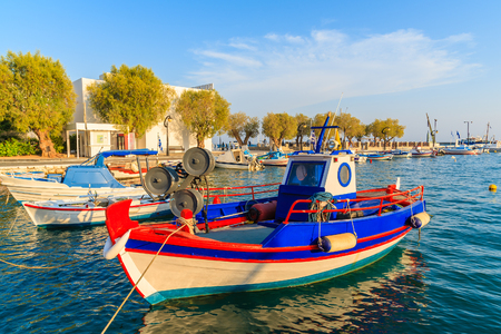Traditional colourful Greek fishing boat in Pythagorion port at sunset time, Samos island, Greece