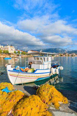 Greek fishing boat in sunrise light, Samos island, Greece