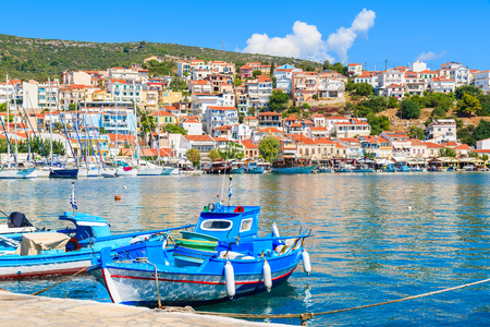 Traditional blue and white colour Greek fishing boats in Pythagorion port, Samos island, Greece