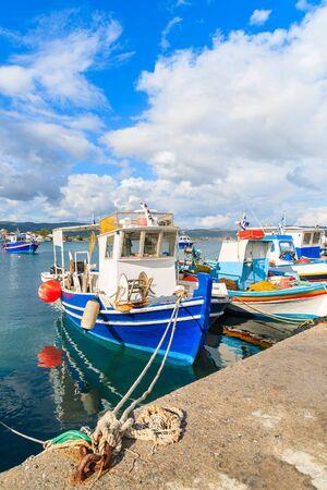 Greek fishing boats mooring in port on Samos island, Greece Stock Photo
