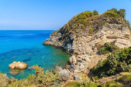 Sea bay with crystal clear water on coast of Samos island, Greece
