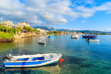 Greek fishing boats in sea bat near port at sunrise time on Samos island, Greece Stock Photo