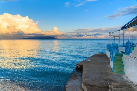 Greek restaurant on beach at sunset time, Samos island, Greece
