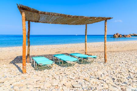 Sunchairs on Potami beach, Samos island, Greece Stock Photo