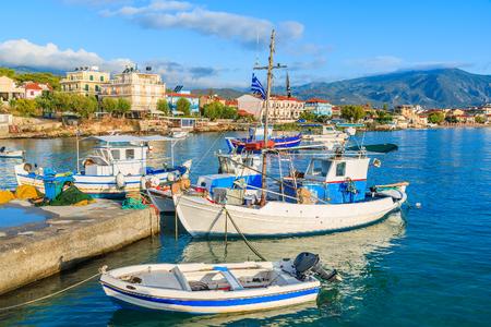 Greek fishing boats mooring in port in sunrise light, Samos island, Greece