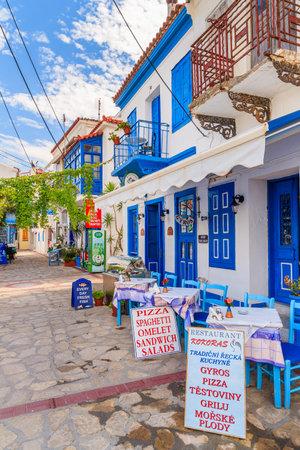 SAMOS ISLAND, GREECE - SEP 24, 2015: blue and white color traditional Greek tavern in Kokkari town on coast of Samos island, Greece