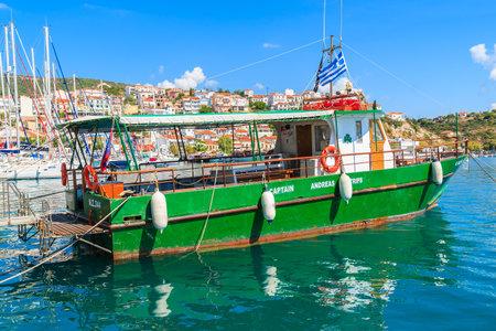 SAMOS ISLAND, GREECE - SEP 25, 2015: Greek tourist boat on sea water in Pythagorion port, Samos island, Greece. Editorial