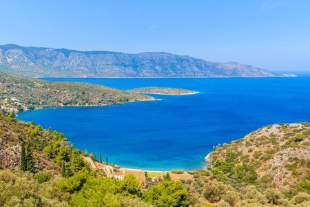 View of beautiful bay with beach and houses on coast of Samos island, Greece Stock Photo