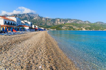 View of Kokkari beach and town houses in distance, Samos island, Greece Stock Photo