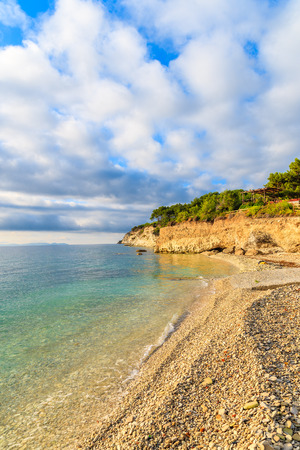 View of beach with beautiful clouds on blue sky, Samos island, Greece Stock Photo