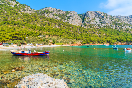 Traditional fishing boat in sea bay on secluded beach, Samos island, Greece Stock Photo