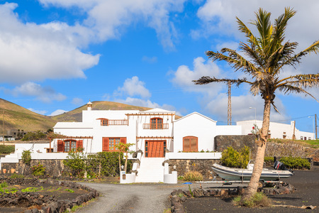 gran canaria: LANZAROTE ISLAND, SPAIN - JAN 17, 2015: typical Canarian house in tropical landscape of Lanzarote island, Spain. Many Europeans buy properties on Canary Islands due to sunny and warm climate.