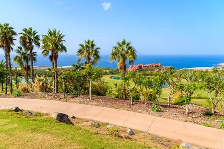 Golf course in tropical landscape of Tenerife island near San Juan town, Spain