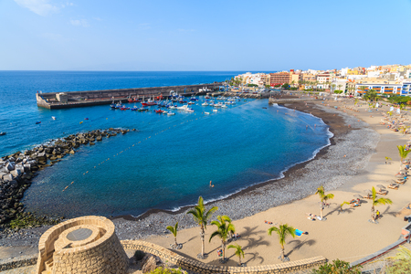 View of beach and San Juan port on Tenerife island, Spain 免版税图像