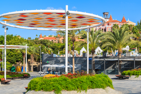 gran canaria: COSTA ADEJE, TENERIFE ISLAND - NOV 17, 2015: public park in Costa Adeje town near El Duque beach on southern coast of Tenerife,
