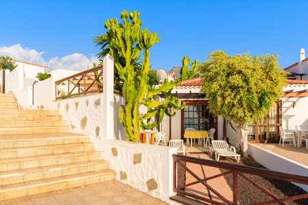 Traditional Canary style holiday apartments in Costa Adeje seaside town, Tenerife, Canary Islands, Spain Stock Photo