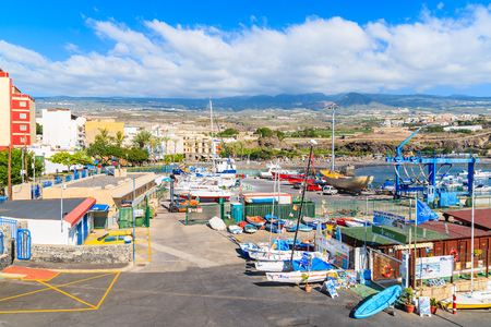 SAN JUAN PORT, TENERIFE ISLAND - NOV 18, 2015: A view of port with boats and yachts in dockyard in San Juan town, Tenerife, Cana Editorial