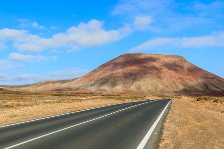 Road to Corralejo along desert with volcanoes, Fuerteventura, Canary Islands, Spain