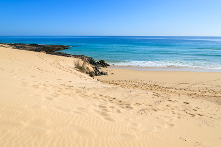 View of sand dunes and ocean in Corralejo National Park, Fuerteventura, Canary Islands, Spain Stock Photo