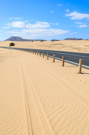 Road in desert landscape of sand dunes in Corralejo National Park, Fuerteventura, Canary Islands, Spain