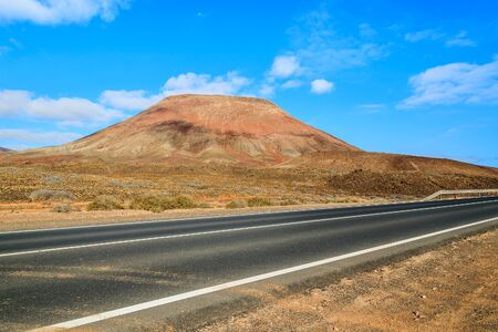 Road to Corralejo along desert with volcanoes, Fuerteventura, Canary Islands, Spain