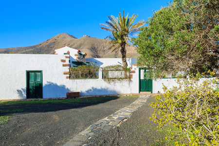 Typical Canary style white house in rural area of Tefia village, Fuerteventura, Canary Islands, Spain Stock Photo