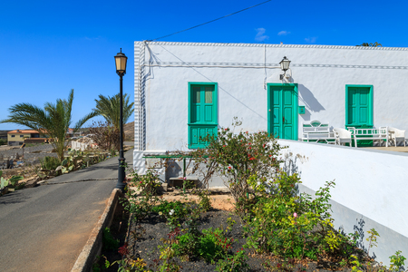 Typical Canary style white house with green doors and windows in rural area of La Oliva village, Fuerteventura, Canary Islands, Spain
