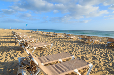 Sunbeds on sandy beach in Morro Jable holiday resort town, Fuerteventura, Canary Islands, Spain Stock Photo
