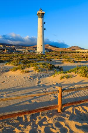 Lighthouse on Morro Jable beach on Jandia peninsula in sunset light, Fuerteventura, Canary Islands, Spain Stock Photo