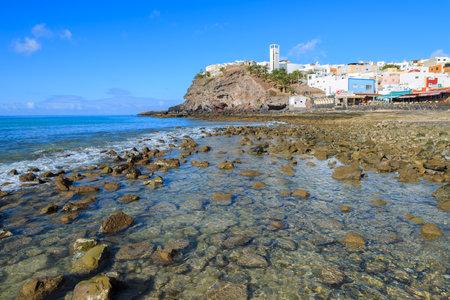 MORRO JABLE, FUERTEVENTURA - FEB 5, 2014: Fishing village Morro Jable on southern coast of Fuerteventura, Canary Islands, Spain. Editorial