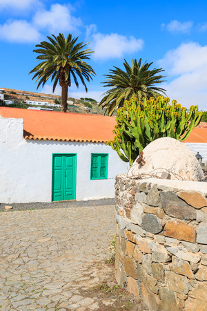Traditional house built in Canary style in Betancuria village and palm trees with stone wall, Fuerteventura, Canary Islands, Spain Stock Photo