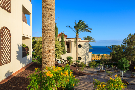 MORRO JABLE, FUERTEVENTURA - FEB 7, 2014: walking alley and holiday bungalows of a luxury hotel in town of Morro Jable. This is a popular place for tourists on Fuerteventura island. Stock Photo