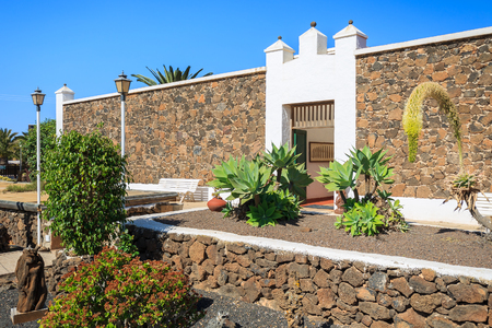 oliva: Canary style buildings and tropical plants in La Oliva village Heritage Art Center, Fuerteventura, Canary Islands, Spain Stock Photo