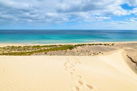 windsurf: Footprints on sand dune on Sotavento beach on Jandia peninsula, Fuerteventura, Canary Islands, Spain
