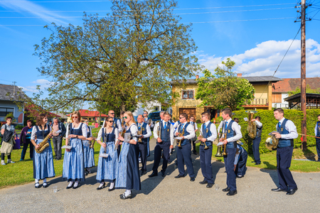 GLASING VILLAGE, AUSTRIA - APR 30, 2016: music band people preparing for a parade during May Tree celebration. In Germany and Austria the maypole is a tradition going back to the 16th century.