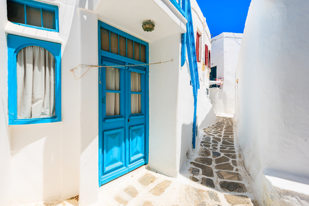 Typical white houses on street of beautiful Mykonos town, Cyclades islands, Greece Banco de Imagens