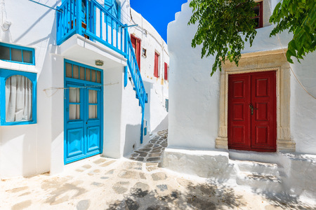 A view of whitewashed street with blue windows and doors in beautiful Mykonos town, Cyclades islands, Greece