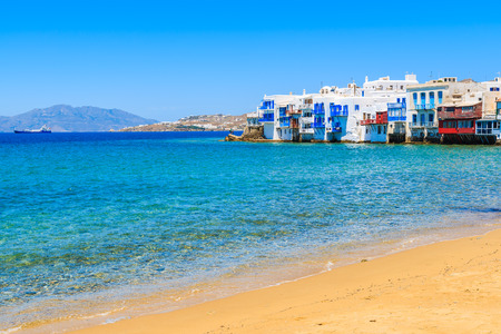 A view of beach and colourful houses in Little Venice part of Mykonos town, Mykonos island, Greece