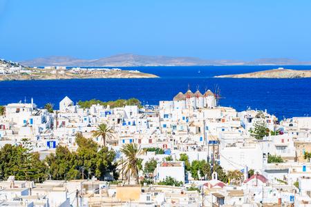 Four famous windmills in Mykonos town against blue sea, Mykonos island, Cyclades, Greece