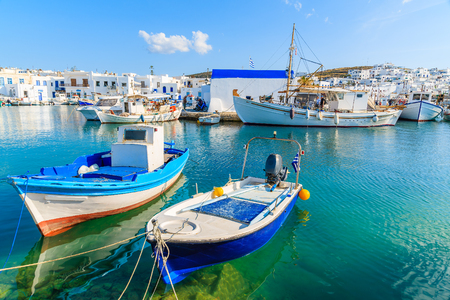 A view of Naoussa port with traditional fishing boats, Paros island, Cyclades, Greece