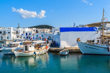 NAOUSSA PORT, PAROS ISLAND - MAY 19, 2016: fishing boats mooring in Naoussa port on Paros island, Greece.