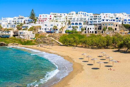 View of beautiful sea bay with beach in Naoussa town, Paros island, Greece