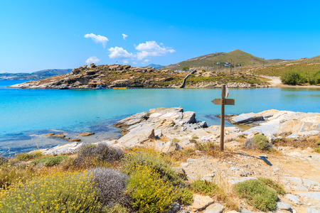 Beautiful coastal path along crystal clear sea water in Monastiri bay on Paros island, Greece