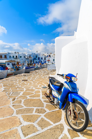 NAOUSSA PORT, PAROS ISLAND - MAY 18, 2016: Old scooter parked in Naoussa port on Paros island, Cyclades, Greece. Editorial