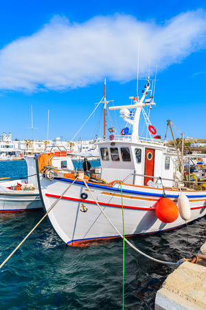 Typical Greek fishing boat anchoring in Naoussa port, Paros island, Greece
