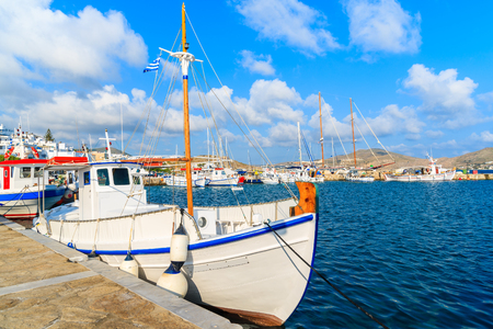 Typical white fishing boat in Naoussa port, Paros island, Greece