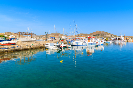 View of fishing boats anchoring in Naoussa port, Paros island, Greece